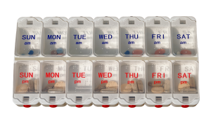 Weekly medication organizer filled with tablets